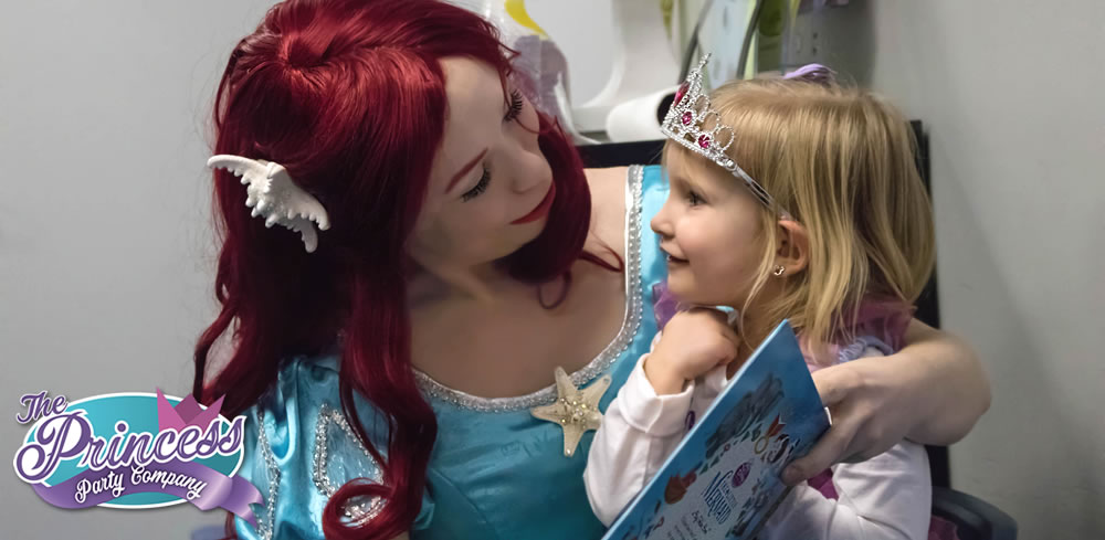 Ariel shares a story at a birthday party